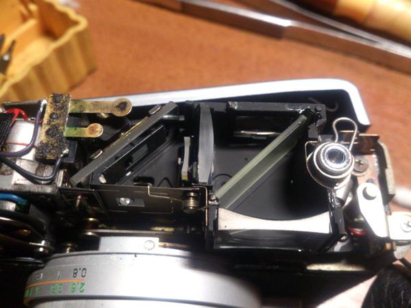 Элементы видоискателя и дальномера Canon Canonet QL17